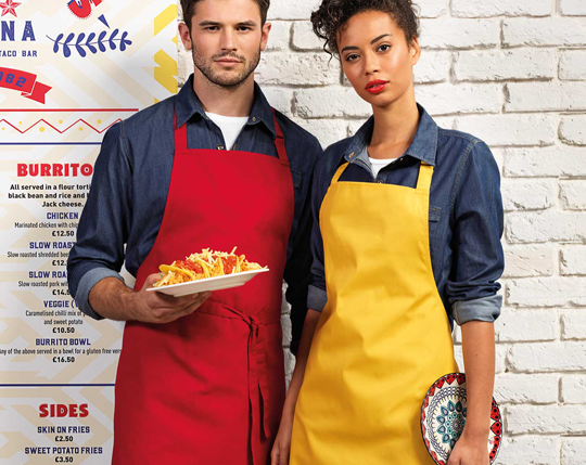 MAN AND WOMAN SERVERS IN RED AND YELLOW APRONS