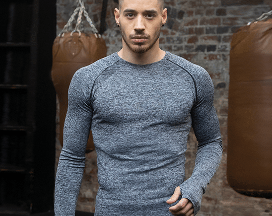 Man in a grey workout top
